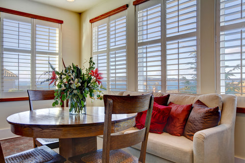 white wooden blinds in rustic dining area