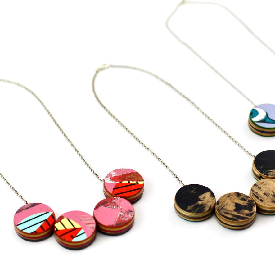 Skateboard statement necklace