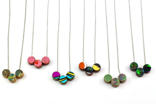 3 sisters skateboard necklace