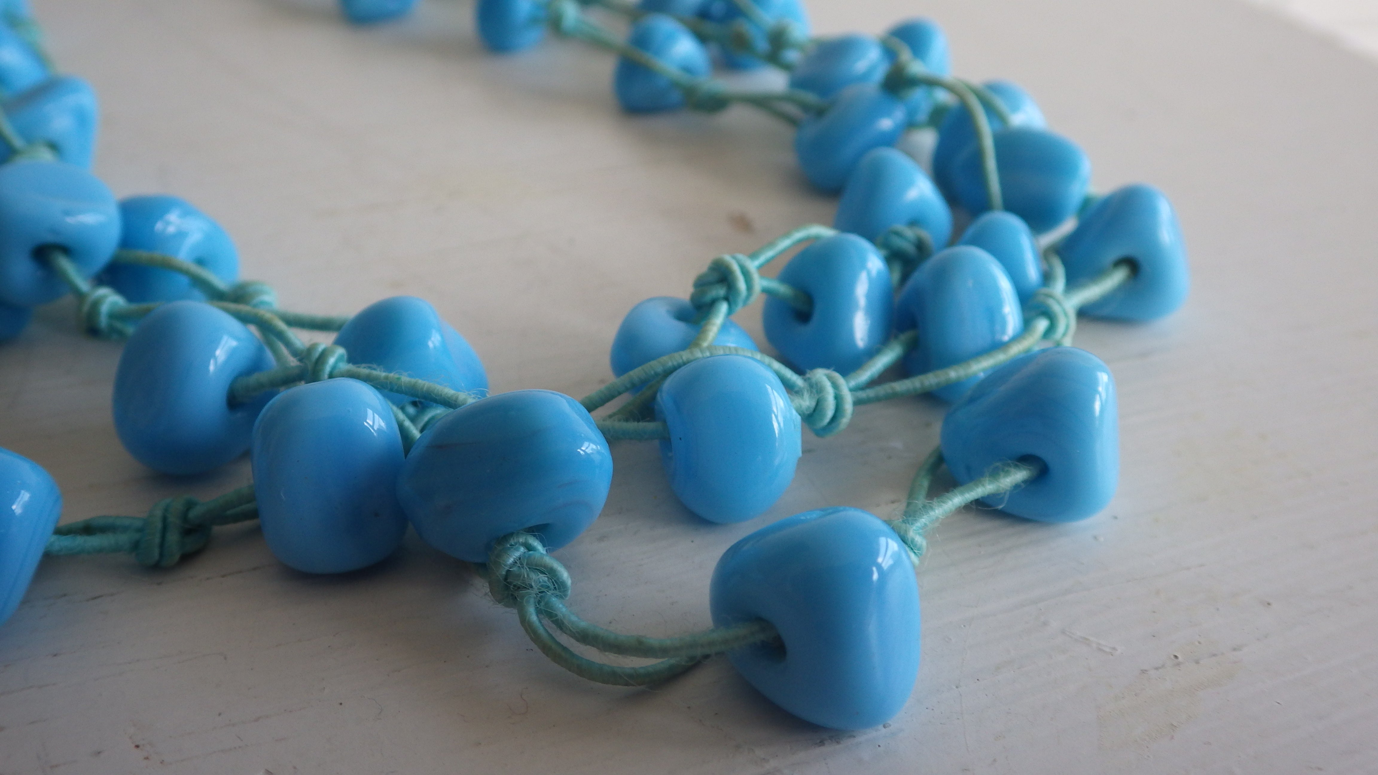 VINTAGE TRIPLE STRAND TIED BLUE GLASS NECKLACE