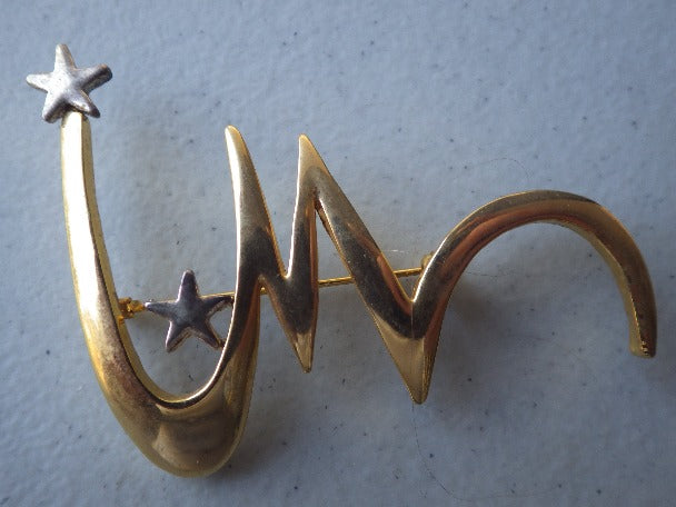 "STARBURST ""M"" OR ""W"" GOLD TONE BROOCH"