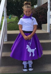 Girl in Pookey Snoo child purple poodle skirt, matching purple scarf, and white initial t-shirt