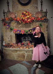 Young lady in Pookey Snoo child light pink poodle skirt blowing kiss