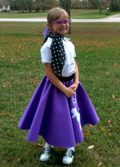 Girl in Pookey Snoo child purple poodle skirt with polka dot scarf