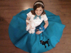 Girl in Pookey Snoo child turquoise poodle skirt with matching scarf