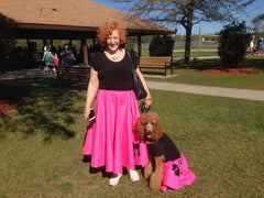 Woman in Pookey Snoo adult bubblegum pink poodle skirt with poodle in matching child bubblegum pink poodle skirt