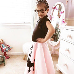 Girl in Pookey Snoo child light pink poodle skirt with cat eye glasses