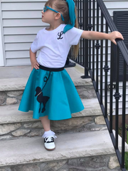 Girl in Pookey Snoo child turquoise poodle skirt with scarf and initial t-shirt