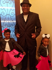 Daughters in Pookey Snoo child fuschia poodle skirt and child bubblegum pink poodle skirt with their Dad