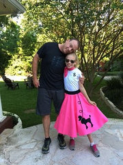 Girl in Pookey Snoo bubblegum pink poodle skirt with dad