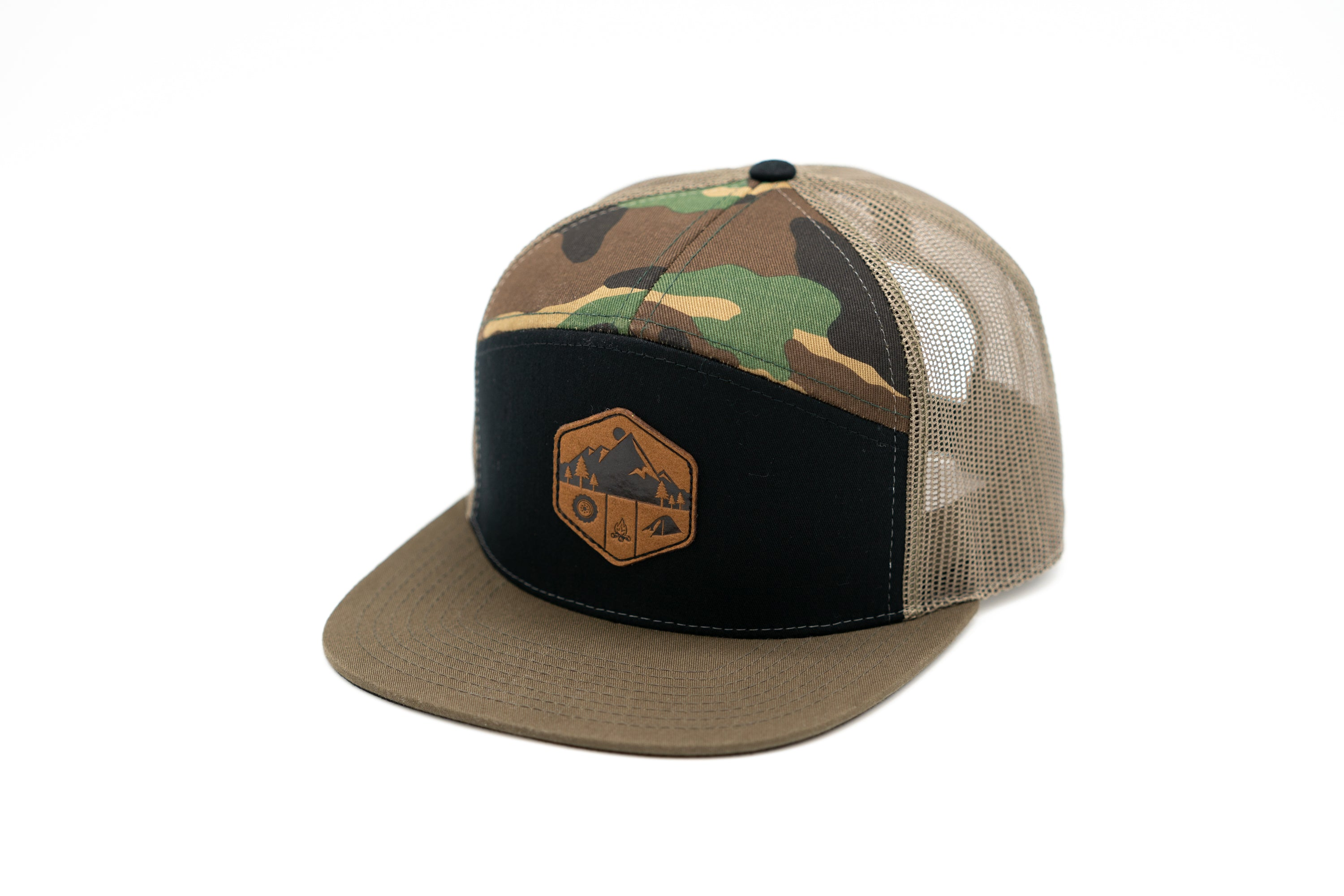 7 Panel Snapback Trucker Hat With Leather Camp Motif Patch - Black Front Panel Camo Top Pannels and Tan Mesh Back