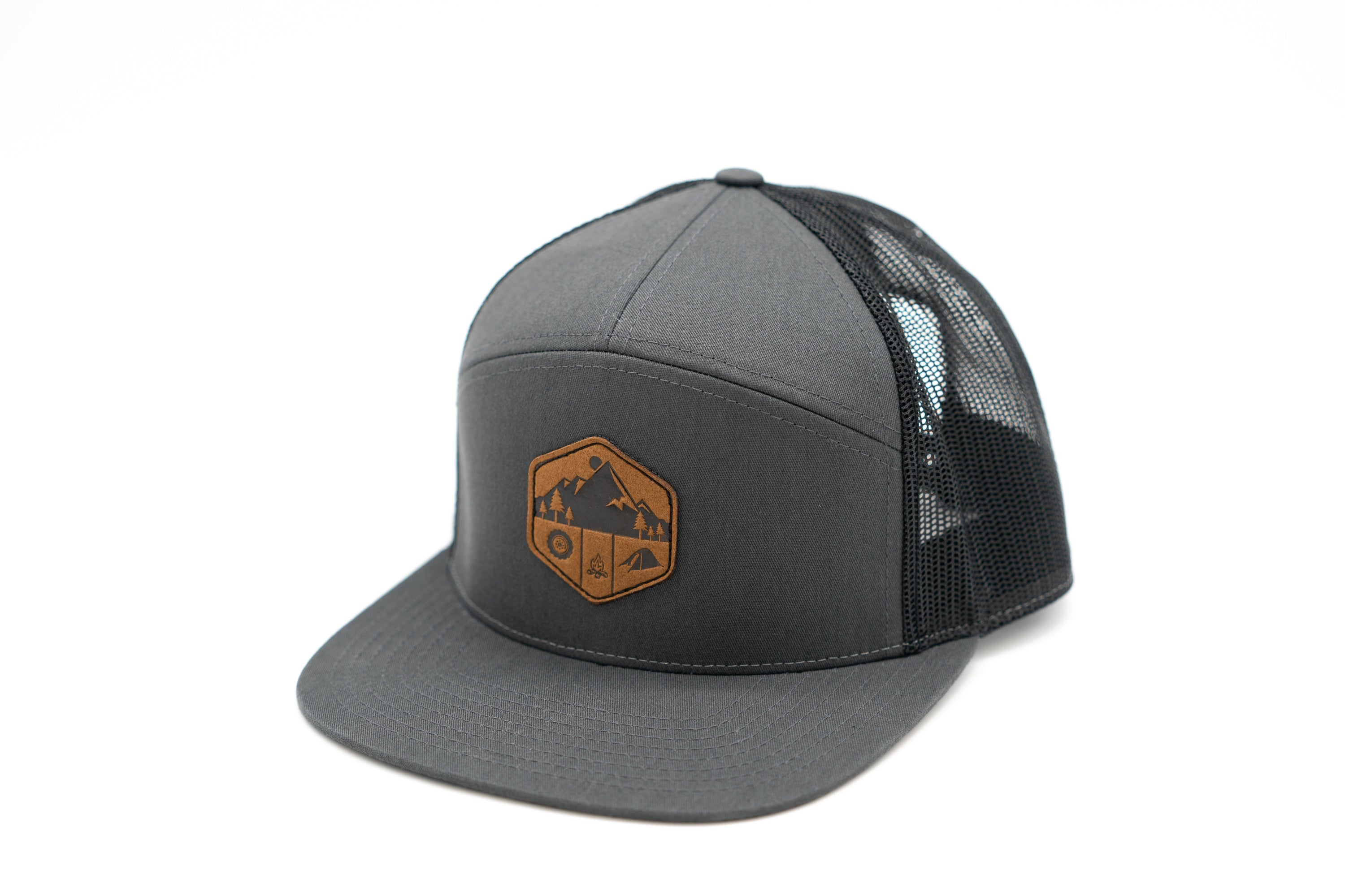 7 Panel Snapback Trucker Hat With Leather Camp Motif Patch - Charcoal Front and Black Mesh Back
