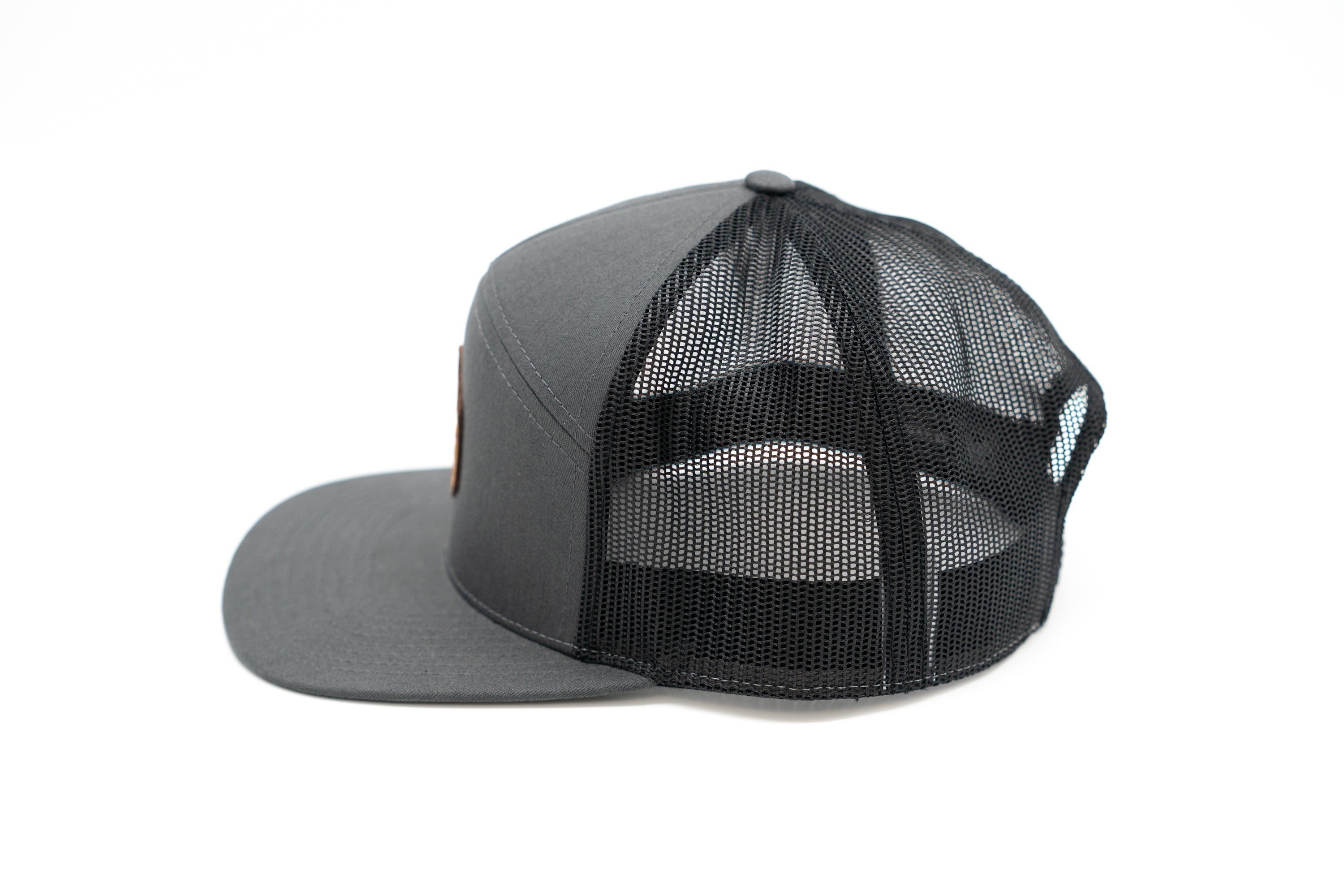 7 Panel Snapback Trucker Hat With Leather Camp Patch - Charcoal/Black