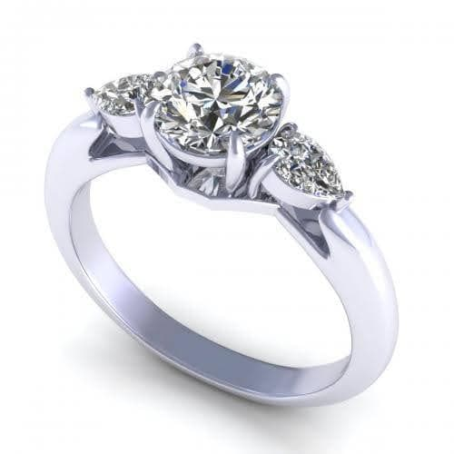 0.65 CT Pear & Round Cut Diamonds - Three Stone Ring