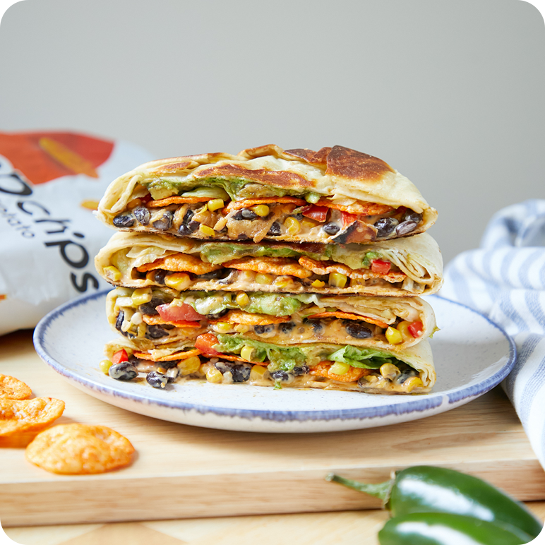 healthier version of a crunch wrap supreme - a quesadilla made with black beans, salsa, lettuce and popchips for some crunch