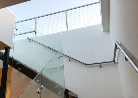 Glass adapter stair railing by Q-Architecture, Inc.