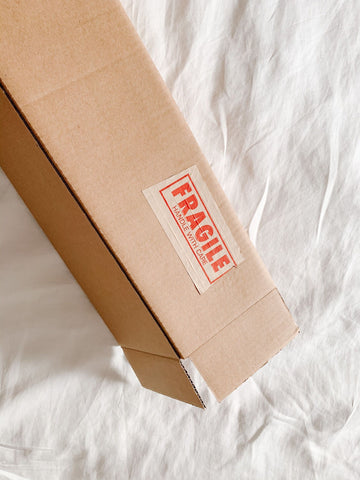 plastic-free packaging in sustainable materials using cardboard and kraft paper tape