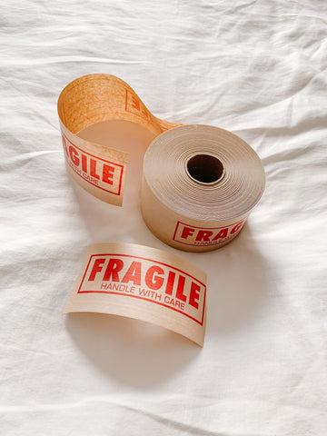 kraft packing tape, fragile kraft packing tape, sustainable packaging, eco-friendly packaging, green shipping,