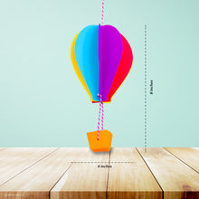 Load image into Gallery viewer, This picture shows The Kids Craft's Cherish the Rainbow Craft Kit - 3D Hot Air Balloon that your kid will be able to create once they are done.  Let your kid be a creator with this Craft Kit Box - The Kids Craft, a Creativeana LLC company creation. Your kid will love The Kids Craft's Cherish The Rainbow Crafts as they create their own hot air balloon, decorate their rainbow, create a bracelet, and create their art masterpiece.