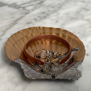 golden shark jewelry dish made from a clam shell