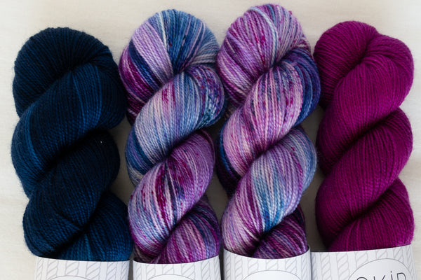 Four skeins of Skip Rope Yarn Co hand dyed yarn