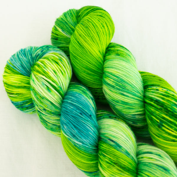 Skip Rope Yarn Co hand dyed yarn - two skeins of bright green and blue speckled yarn