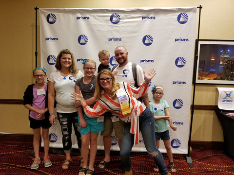 The Dostal family posing with Rose Morris, founder and president of Abram's Nation maker of The Safety Sleeper at the Smith Magenis Syndrome conference in 2019