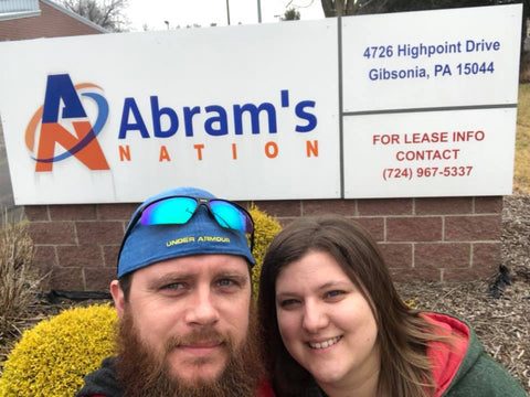 Jason and Tabitha Dostal pose in front of Abram's Nation