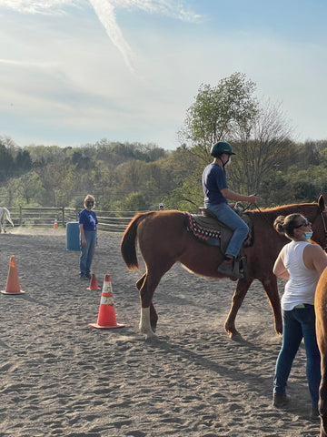 Abram riding a horse - teen with Autism
