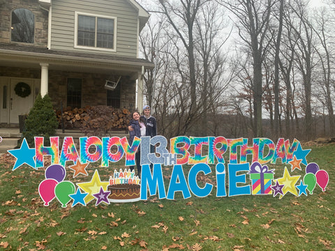 """Rose's front yard decorated with large letters that say """"Happy Birthday Macie"""""""