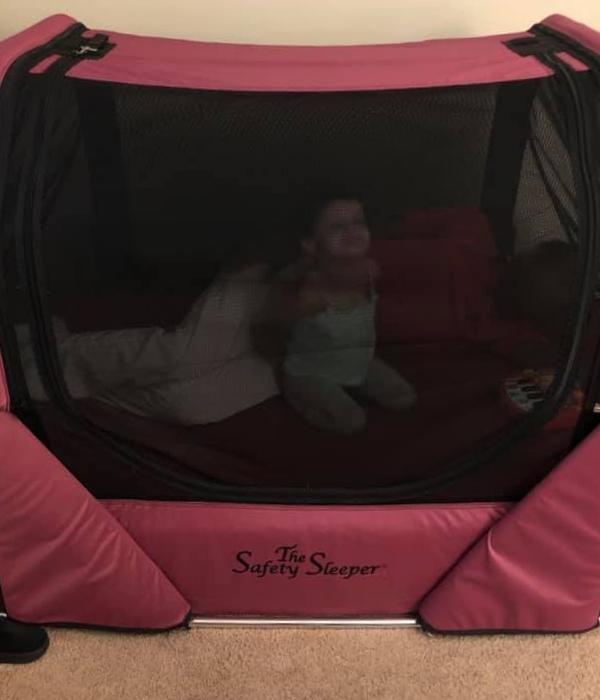 Young girl in The Safety Sleeper enclosed bed for children and adults with special needs