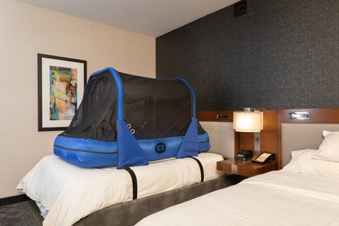The Safety Sleeper Travel Safety Bed in a Hotel Room