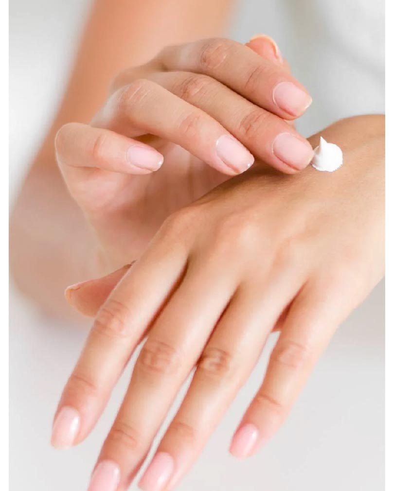 female hands applying moisturiser