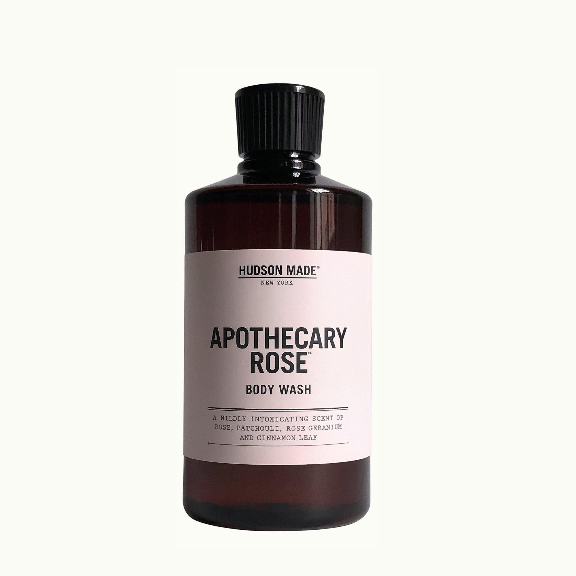A brown bottle with screw off cap with a light pink label that reads Hudson Made Apothecary Rose Body Wash