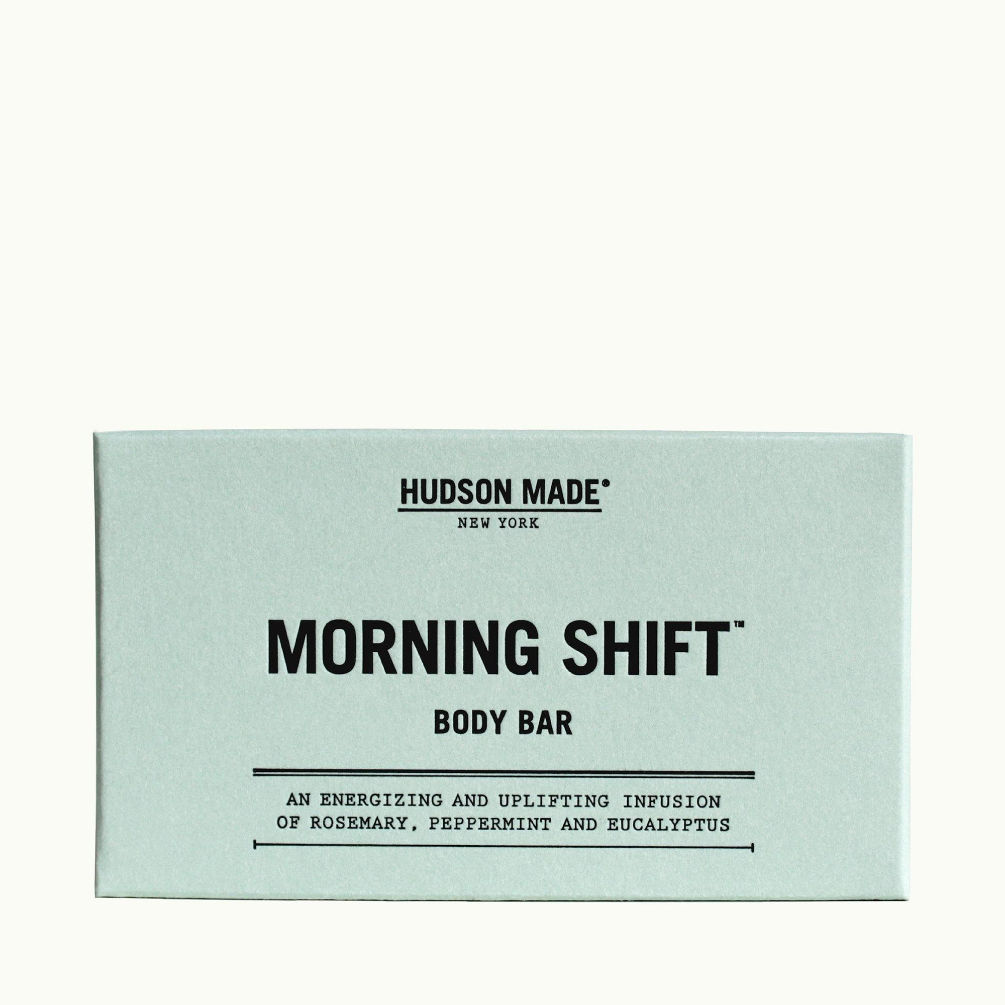 The light blue grey packaging of the Hudson Made Morning Shift Body Bar Soap