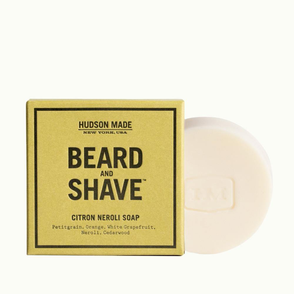 The tan packaging of the square Hudson Made Citron Neroli Beard & Shave Soap