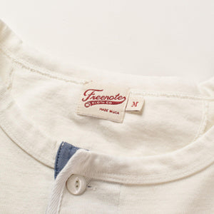 The Freenote Cloth 13 Ounce Henley Long Sleeve Shirt in White. The photo shows the Freenote Cloth logo and Medium tags.