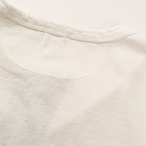 The Freenote Cloth 13 Ounce Henley Long Sleeve Shirt in White. The back of the collar on the shirt is shown.