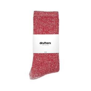 The Druthers Merino Wool House Socks in Red folded in half with white packaging around the middle of the socks.