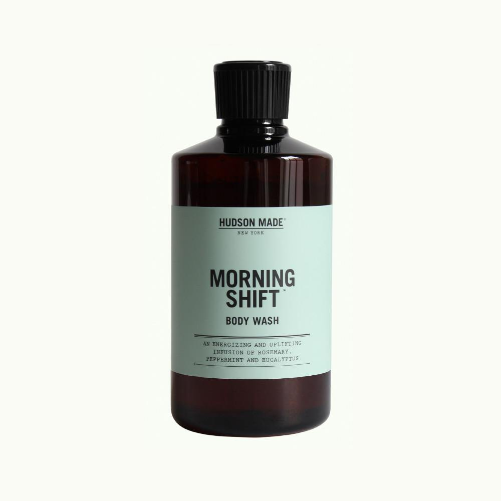 A brown bottle with screw off cap with a light blue/grey label readingHudson Made Morning Shift Liquid Body Wash