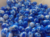 100 pc White w/Blue Splatter Oval Glass Beads