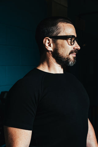Handsome man with glasses wearing black Urban Jersey