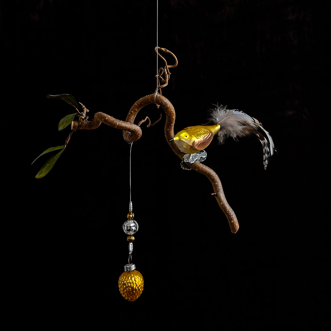 Yellow Bird With Feather Tail and Gold Walnut