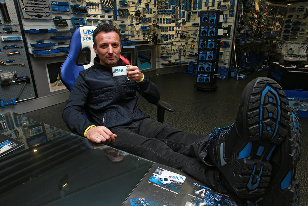 Darren Turner drinking a coffee in the Laser Tools Showroom.