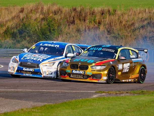 Aiden Moffat's Infinity Q50 gets tapped by Carl Boardley's BMW during race 3 at Thruxton 2020