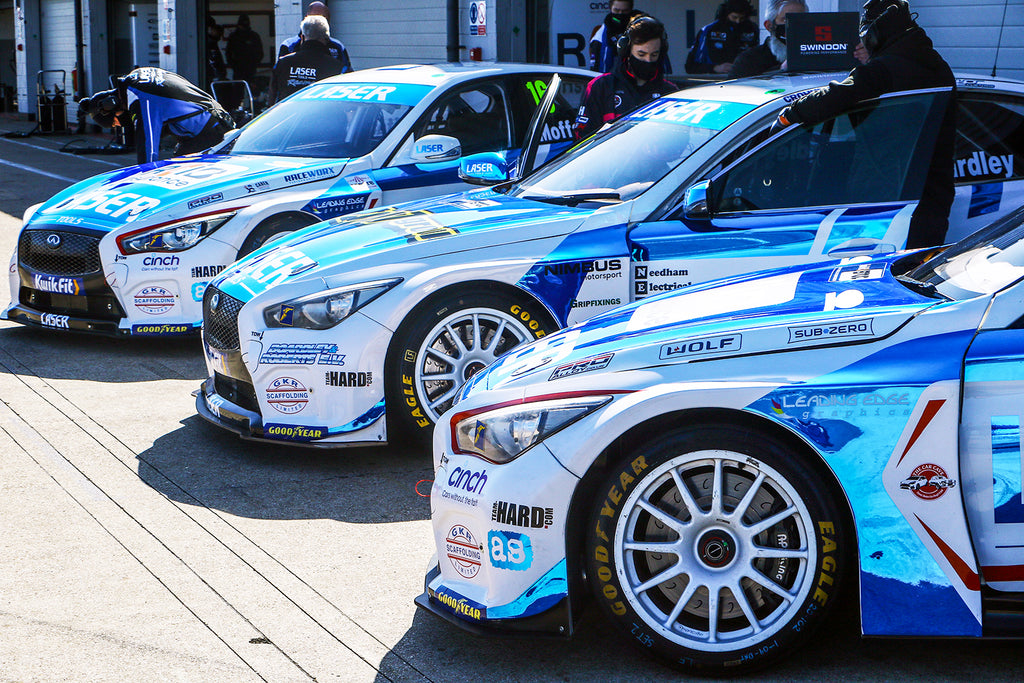Laser Tools Racing 3 Infinity Q50s outside the garages at Silverstone during BTCC season launch.
