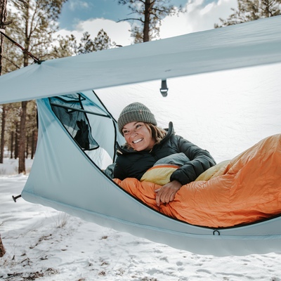 Girl in blue haven tent hammock