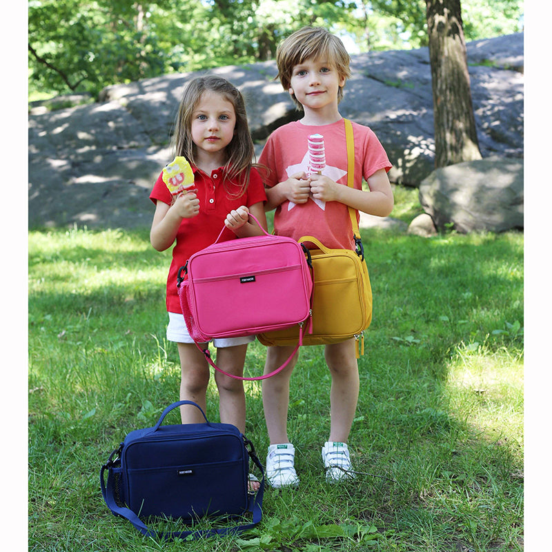 little kids carrying Perry Mackin lunch boxes