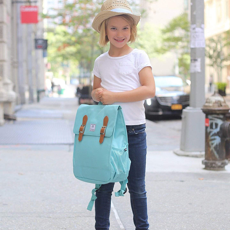 little girl holding light blue Perry Mackin backpack