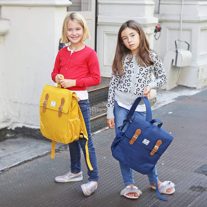 Image of 2 little girls carrying yellow and navy Perry Mackin backpacks